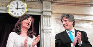 Argentina's President Fernandez de Kirchner talks to Vice President Boudou after arriving for the opening session of the 132nd legislative term of Congress in Buenos Aires